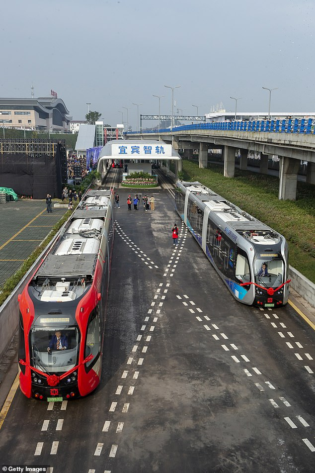 The bizarre concept of a locomotive that doesn't need traditional tracks is being pioneered in China, with it now being the first to open for commercial use (pictured)