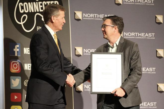 NEMCC President Ford accepting award from Apple's Jon Landis (photo credit Daily Journal)