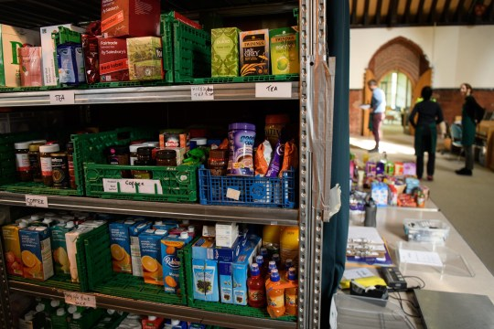 LONDON, ENGLAND - MAY 05: Volunteers at Wandsworth foodbank prepare parcels for guests from their stores of donated food, toiletries and other items on May 5, 2017 in London, England. The Trussell Trust, who run the food bank, report that dependency on their service is continuing to rise, with over 1,182,000 three day emergency food supplies given to people in crisis in the past year. 436,000 of these recipients were children. (Photo by Leon Neal/Getty Images)