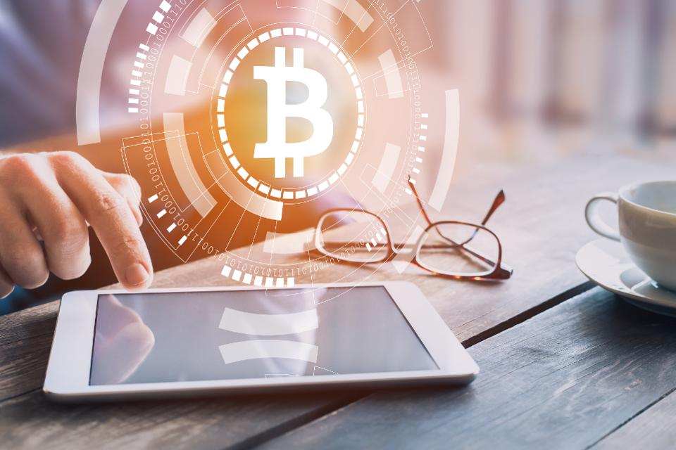 Bitcoin cryptocurrency investing, trading concept, businessman, digital tablet, BTC symbol