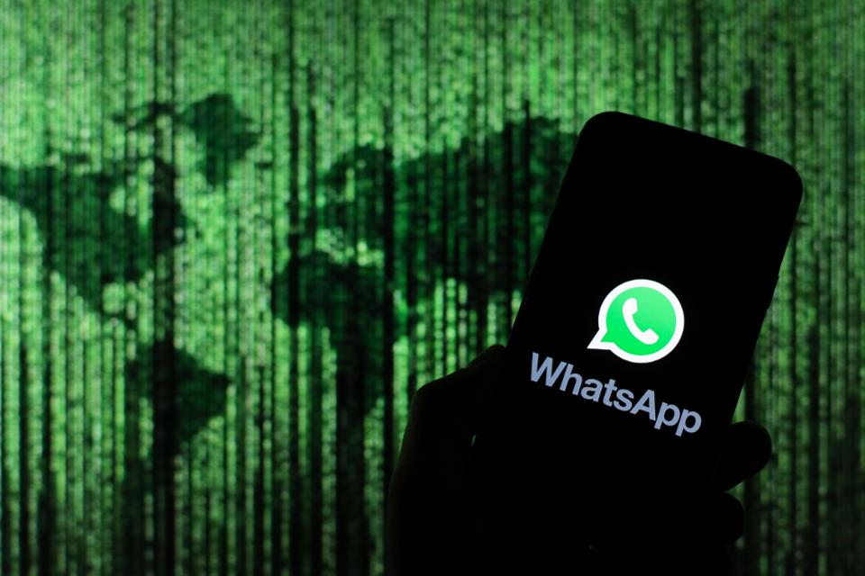 In this photo illustration a WhatsApp messenger app logo...