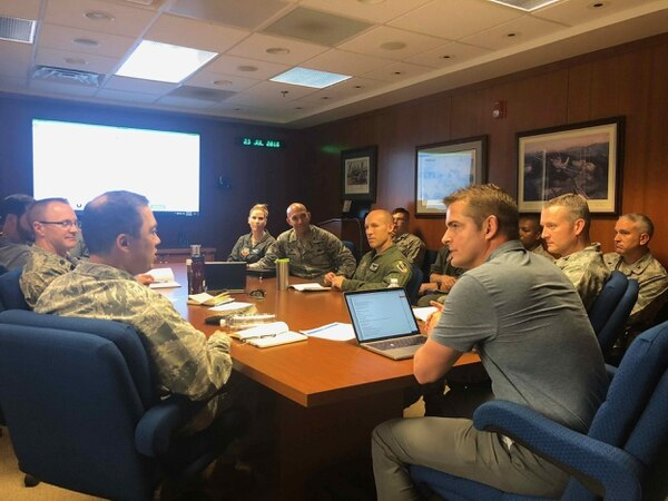 Col. Donn Yates, a few weeks into his command, and his team discuss innovation with Tommy Sowers on July 23, 2018. (Courtesy of Tommy Sowers)