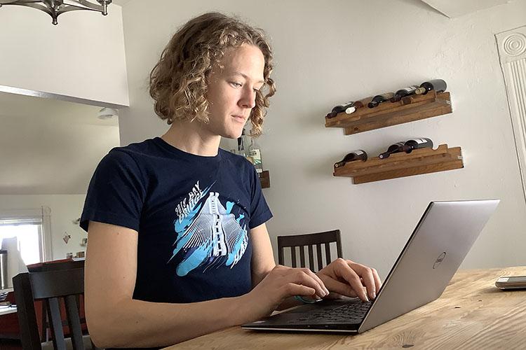Elise Baker, a recent Berkeley Law graduate, works on her laptop.