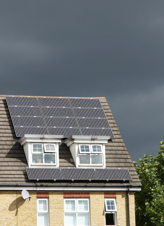 Solar panels on roof of house providing electricity.