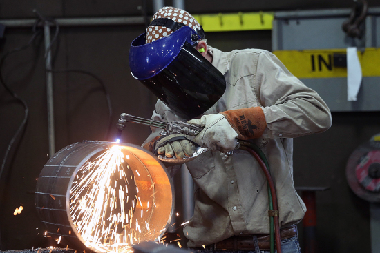 An employee welds pipe at Pioneer Pipe in Marietta, Ohio, on Oct. 25, 2016. The construction, maintenance, and fabrication company supplies products to the oil and gas industry.