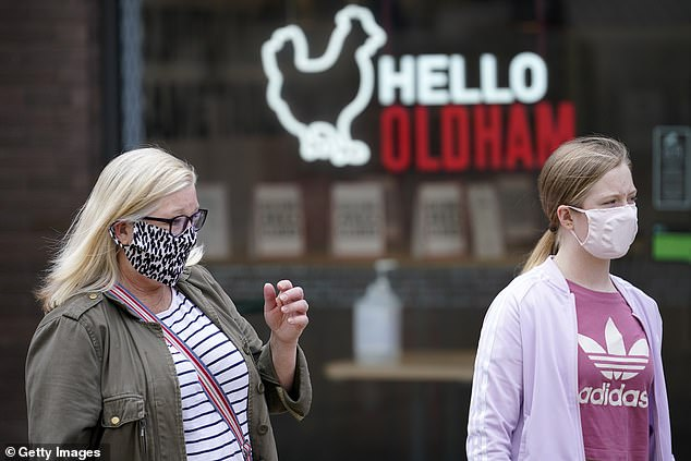 The council said 255 new cases were diagnosed in the week ending August 8 compared with 137 cases the week before. Pictured: People wearing face masks while shopping on July 29