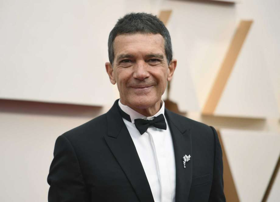 FILE - Antonio Banderas arrives at the Oscars in Los Angeles on Feb. 9, 2020.  Banderas says he's tested positive for COVID-19 and is celebrating his 60th birthday in quarantine. The Spanish actor announced his positive test on Instagram on Monday. (Photo by Richard Shotwell/Invision/AP, File) Photo: Richard Shotwell, Richard Shotwell/Invision/AP / 2020 Invision