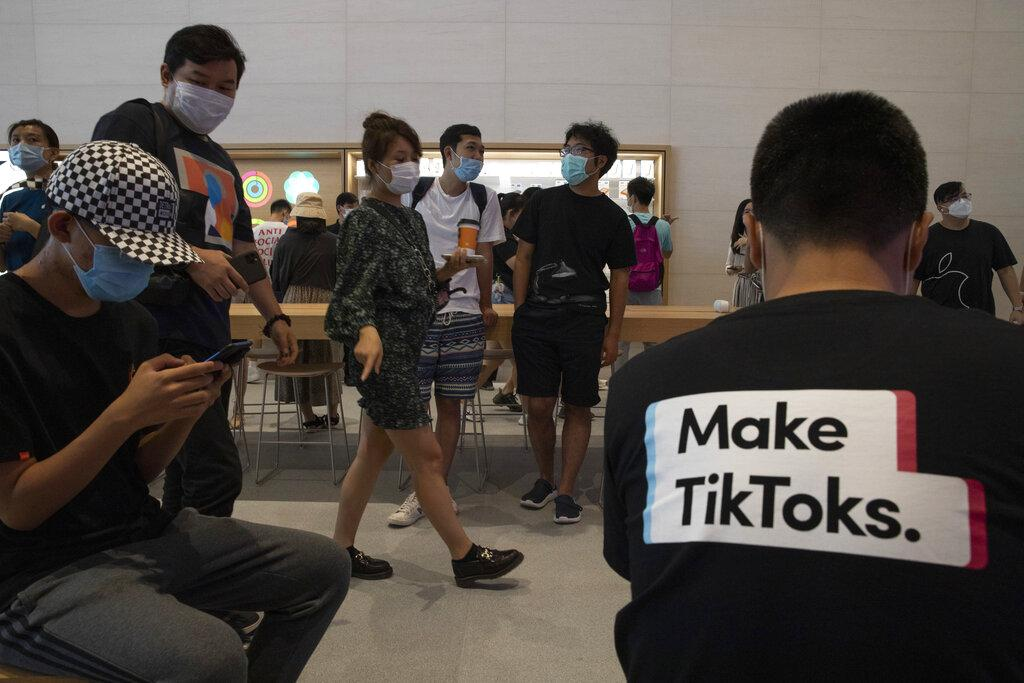 A visitor to an Apple store wears a T-shirt promoting TikTok in Beijing on Friday, July 17, 2020. (AP Photo / Ng Han Guan)