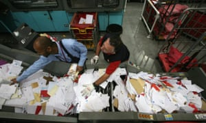 Royal Mail staff sort Christmas cards in the Filton sorting office, near Bristol.