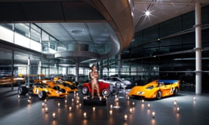 A statue of Bruce McLaren surrounded by racing cars of yesteryear at the Norman Foster-designed facility.
