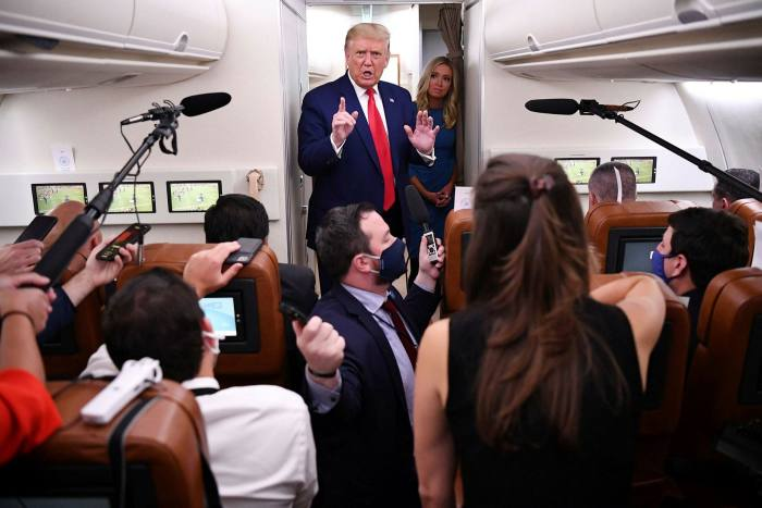 Donald Trump speaks to reporters on Air Force One. The president's announcement on an earlier flight that TikTok needed to be banned came as a complete surprise to his aides