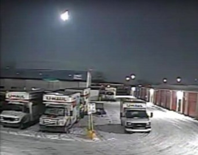 ***EMBARGOED UNTIL 14.00 GMT, TUES OCT 27 (10.00 ET)*** Security camera footage of the fireball in the sky over Toledo, Ohio. See SWNS story SWNNmeteor; A 'fireball' space rock that smashed into a frozen lake holds the key to the origins of life on Earth, according to new research.The six foot meteor lit up the night sky as it streaked over the US nearly three years ago. It was travelling at about 30,000 mph before breaking up 20 miles above the ground - and crashing into a lake oin Michigan. Scientists used weather radar to locate the pieces which were quickly collected by meteorite hunters - before its chemical makeup got changed by liquid water. Now an analysis published in Meteoritics & Planetary Science has provided a glimpse of what they are like when they are still in outer space.