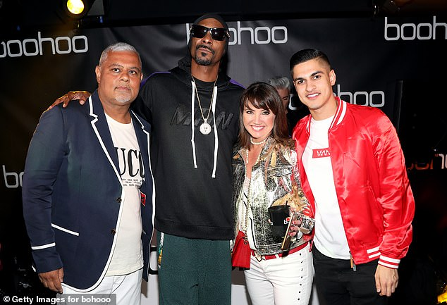 Boohoo'schairman and co-founder Mahmud Kamani (left, pictured with Snoop Dogg, Carol Kane and Samir Kamani) bought 300,000 shares at 243p each, upping his stake to 12.55%