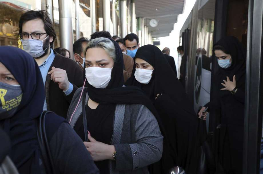 FILE - In this Sunday, Oct. 11, 2020 file photo, people wear protective face masks to help prevent the spread of the coronavirus in downtown Tehran, Iran. For the second day in a row, Iran announced Monday its highest single-day death toll from the coronavirus with 272 people killed. The announcement by Health Ministry spokeswoman Sima Sadat Lari saw Iran also give its single-day highest count of new cases with 4,206 new patients. Photo: Ebrahim Noroozi, AP / Copyright 2020 The Associated Press. All rights reserved.