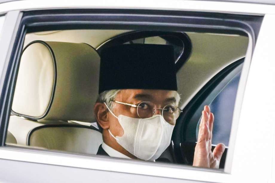 Malaysia's King Sultan Abdullah Sultan Ahmad Shah waves as he leaves National Palace in Kuala Lumpur, Malaysia, Sunday, Oct. 25, 2020. National Palace statement says Malay rulers has decided not to accede to Prime Minister Muhyiddin Yassin's request to declare a state of emergency. Photo: Vincent Thian, AP / Copyright 2020 The Associated Press. All rights reserved