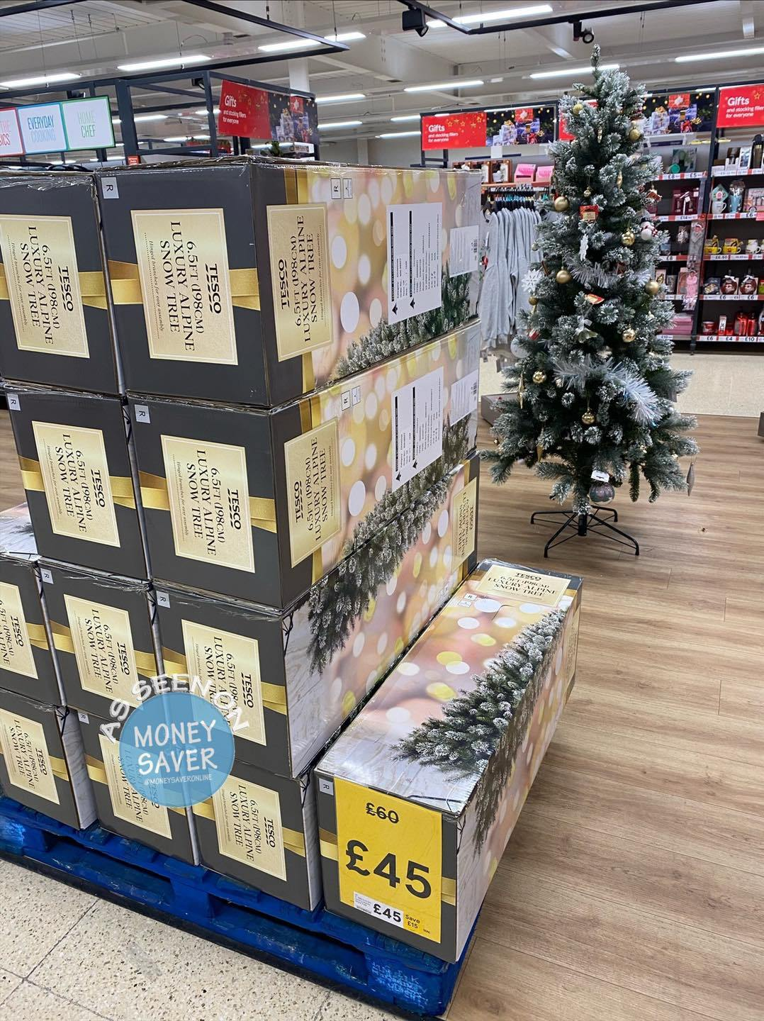 Tesco shoppers can also get this 6ft tree with fake snow at 25% off