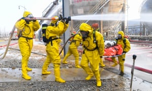 Fire fighters take part in an emergency drill against winter chemical hazards and accidents in Wuhai, north China's Inner Mongolia Autonomous Region, 25 November, 2020.
