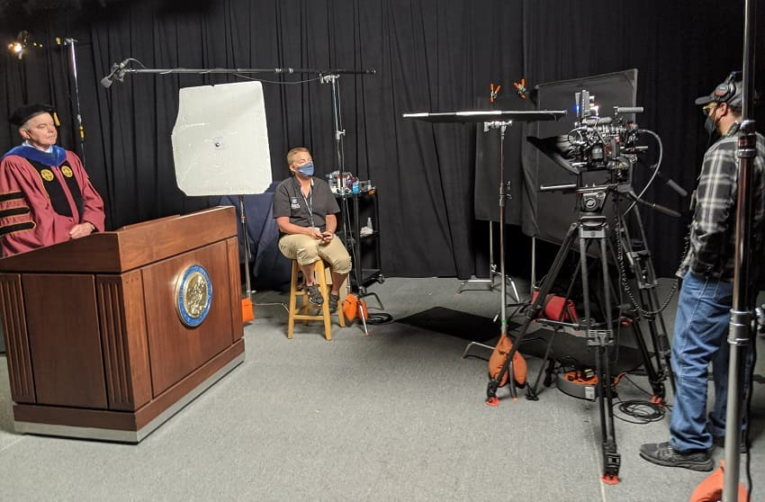 Provost Kevin Carman (left) recording his portion for the 2020 Virtual Commencement Ceremonies, while Maryan Tooker (middle) controls the teleprompter and Kyle Weerheim (right) operates the camera.