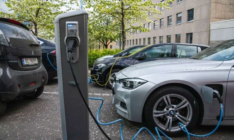 Electric cars being charged on a street in Oslo.Norway has become the first country where more than half of new cars are electri
