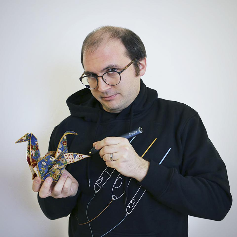 3Doodler Co-Founder and CTO Maxwell Bogue draws on a design with a 3D pen