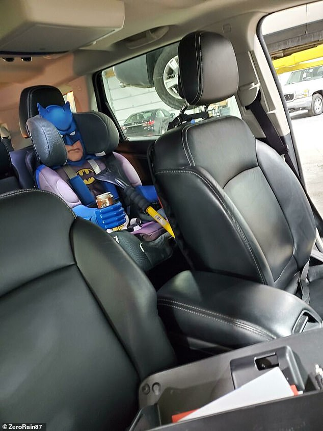 A child's Batman-themed carseat caused a mechanic to leap out of his skin as he thought it was a person sitting in the back of the seat at a first glance