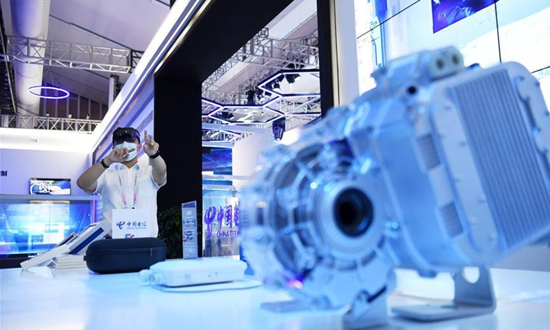 A staff member presents an exhibit during the 2020 Smart China Expo Online in southwest China's Chongqing Municipality, Sept. 15, 2020. The expo serves as a platform to promote global exchanges of smart technologies and international cooperation of the smart industry. (Xinhua/Tang Yi)