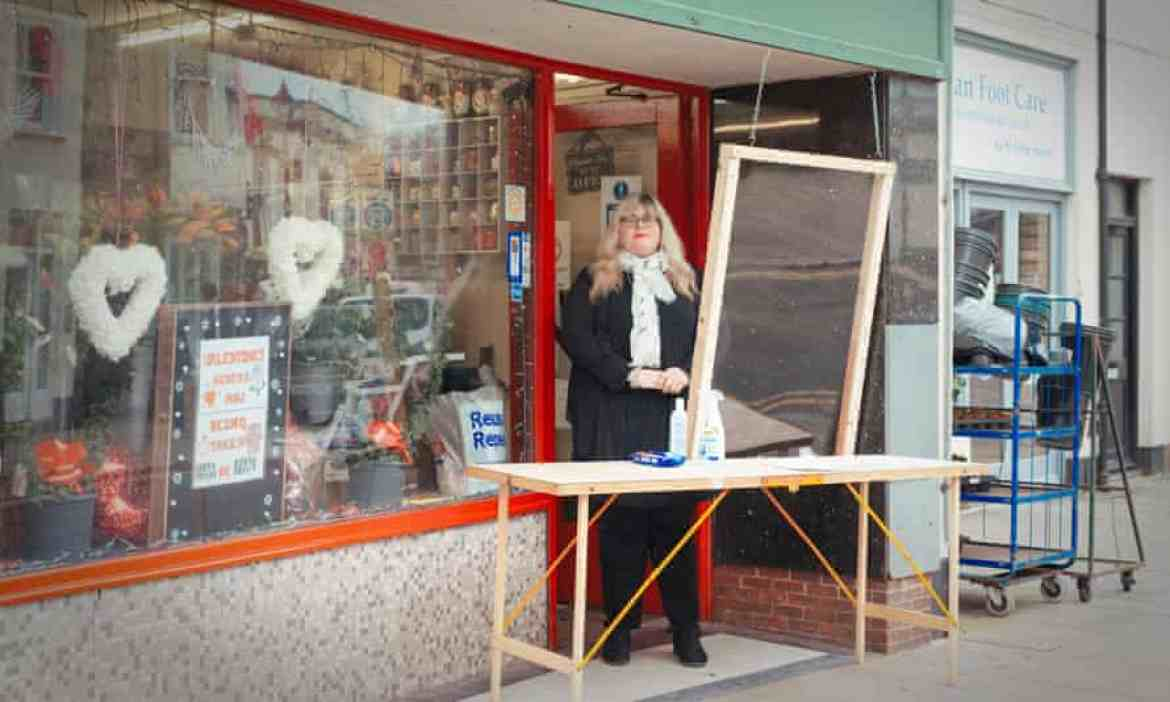 Claire Weston setting up a folding table and screen outside her shop