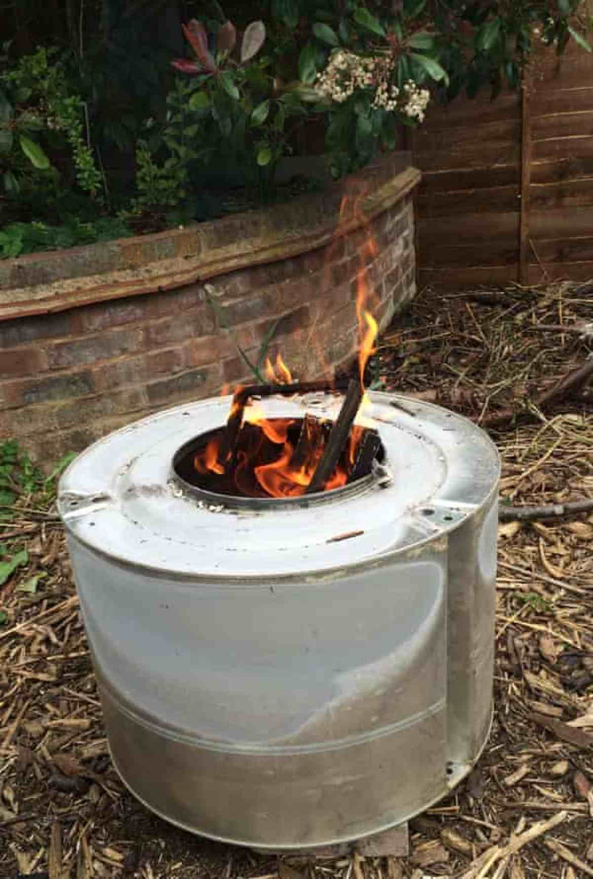 A dryer drum used as a garden incinerator.