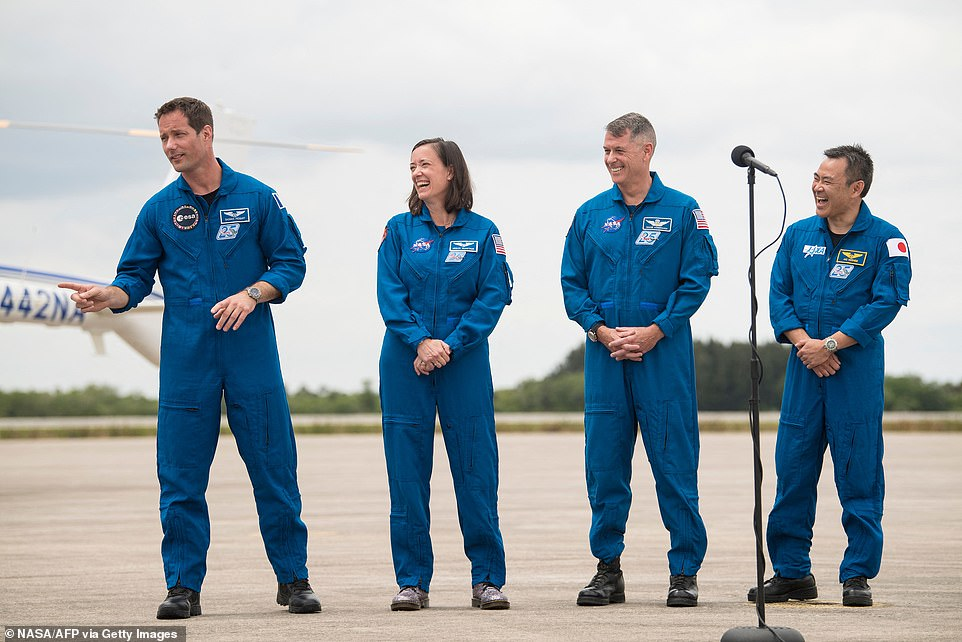The crew members, (from left to Thomas Pesquet, NASA astronauts Megan McArthur and Shane Kimbrough, and Japan Aerospace Exploration Agency (JAXA) astronaut Akihiko Hoshide, also arrived at the site today to watch the craft make the journey
