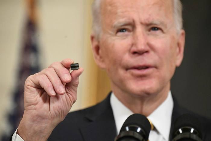 Us president Joe Biden holding a chip