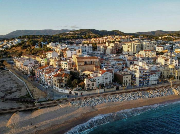 Some families have sold small city-centre flats to live in large houses with gardens half an hour away on the Maresme coast