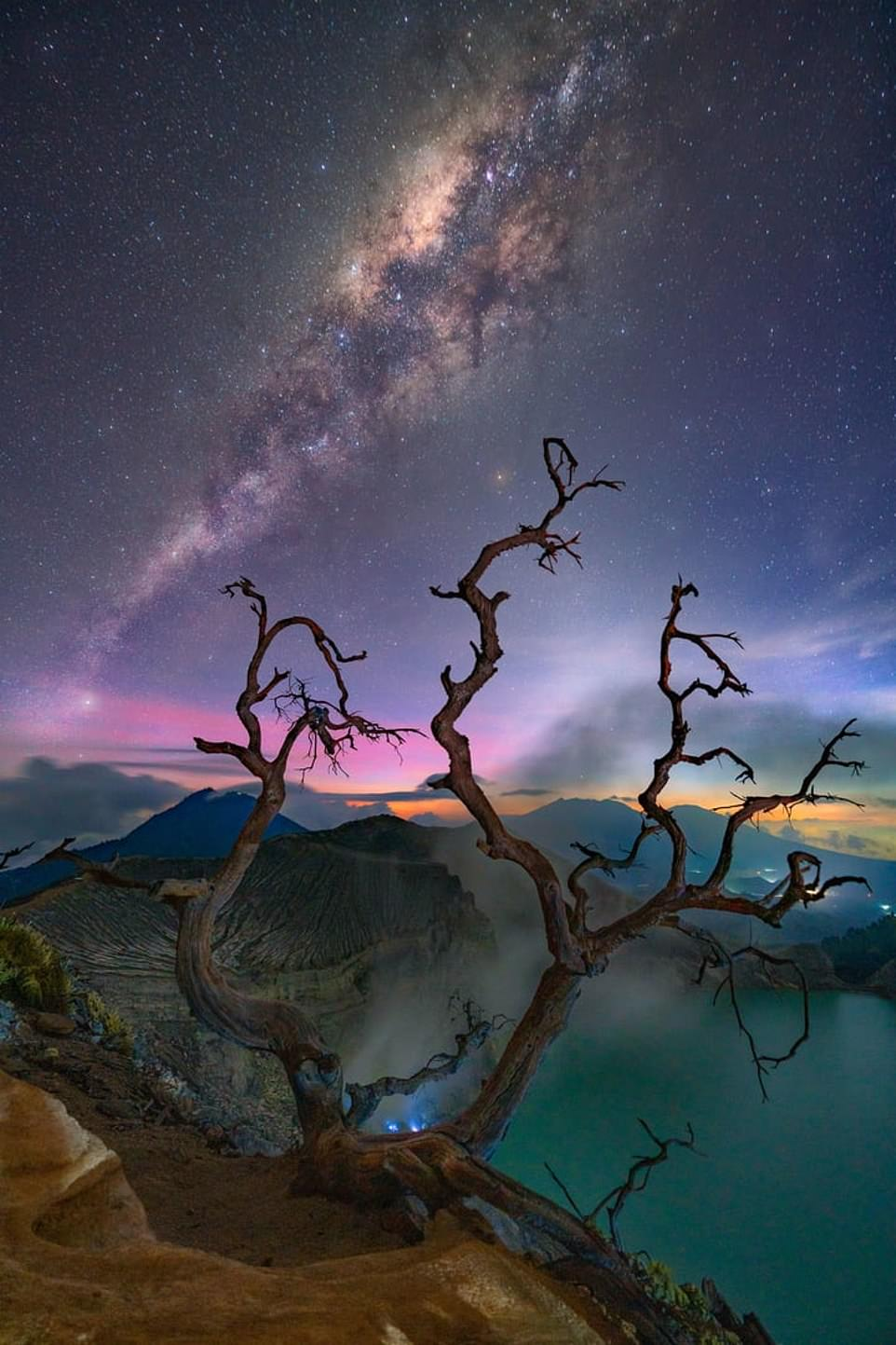 'Around dead trees' — by Gary Bhaztara inJava, Indonesia, whosaid: 'I took this shot of the Milky Way facing south after the sun set in the west. At the same time, the blue fire was burning just below the mountain while the Milky Way kept rising'