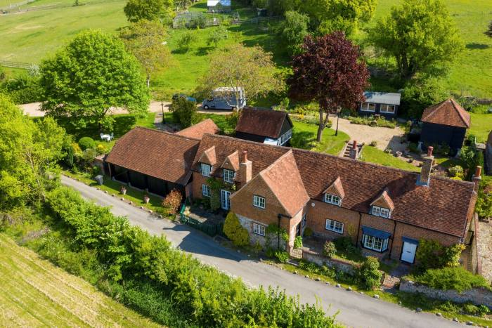 A six-bedroom Grade II-listed farmhouse with 4 equestrian paddocks and stabling in Skirmett, £2.295m