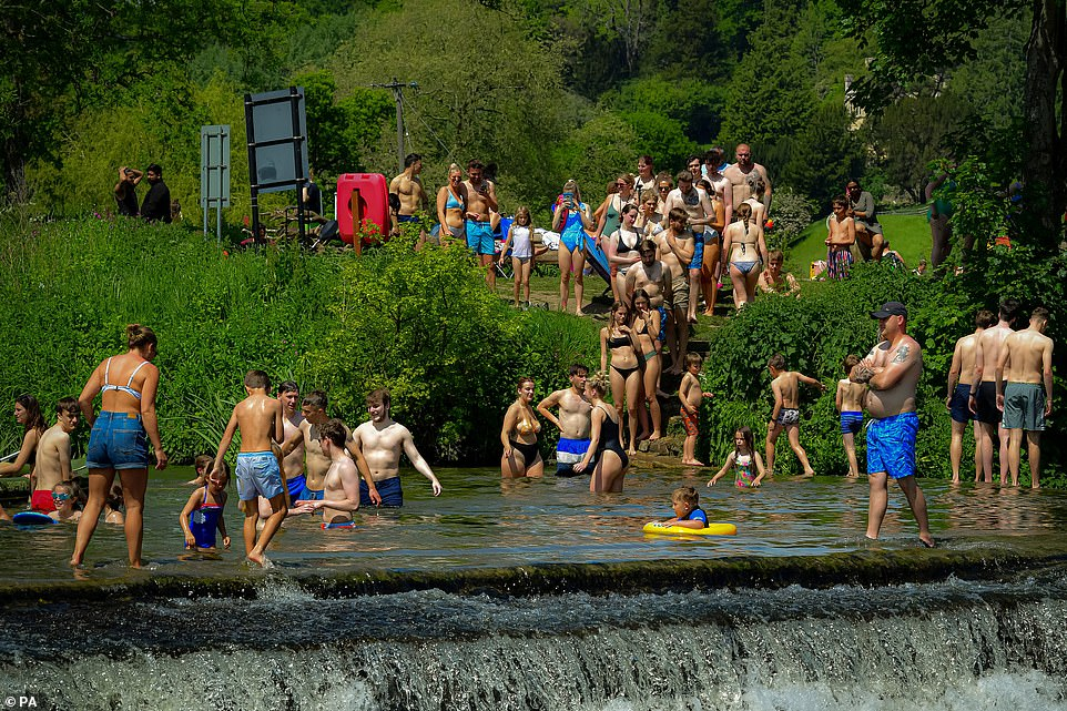 Covid woes have been forgotten this week as the summer weather began in earnest and people enjoyed time outside after an unseasonably cold and wet spring. Pictured: A crowd at Warleigh Weir in Bath today