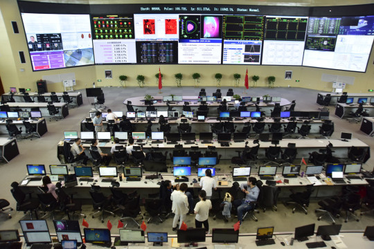HEFEI, CHINA - JUNE 1, 2021 - A researcher works at the physics experiment site of EAST all-superconducting tokamak device in Hefei, EAST China's Anhui province, June 1, 2021. On May 28, 2021, the 16th round of EAST Full Superconducting Tokamak Device (Artificial Sun), Hefei Institute of Physical Science, Chinese Academy of Sciences, carried out the physics experiment of EAST device, and realized the repeatable plasma operation of 120 million degrees 101 seconds and 160 million degrees 20 seconds. The latest world record for the experimental device was set again. (Photo credit should read Costfoto/Barcroft Media via Getty Images)