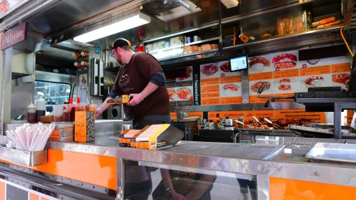 indulge like a food in NYC - what to eat in New York Wafels & Dinges throwdown waffle