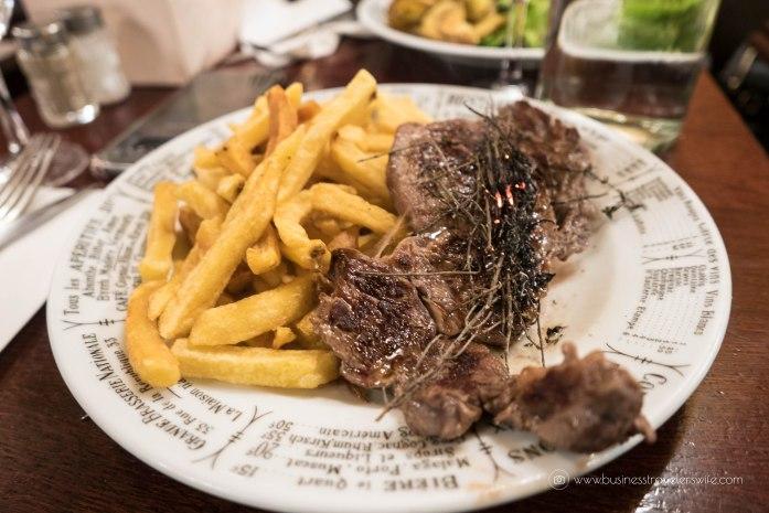 Our List of Must-Try Foods in Paris Bistrot Victoires beef ribeye steak burning wild thyme