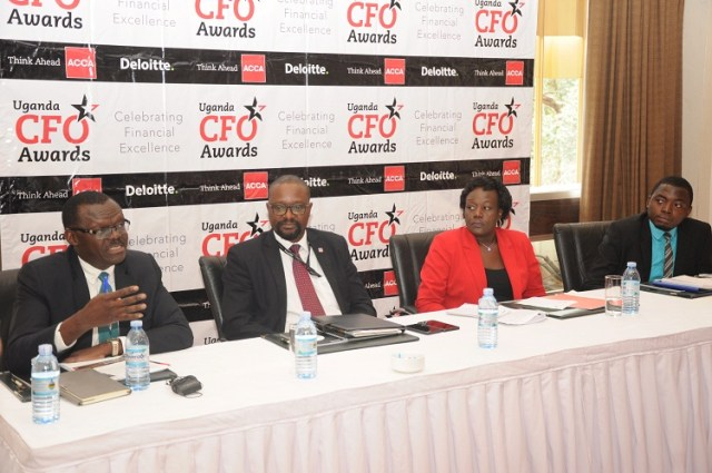 (L-R): Patrick Ayota- Deputy Managing Director NSSF together with Nobert Kagoro- Managing Partner Deloitte, Beatrice Isagayite- Head of ACCA Uganda and Ronald Amega, Chairperson Careers Guidance Committee at ACCA address the media at the launch of the 2nd edition of the annual CFO awards at the Kampala Serena Hotel