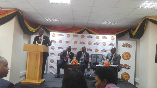 Kasekende speaking at a Function where Equity Bank marked 10 years anniversary with a move to Church House building.
