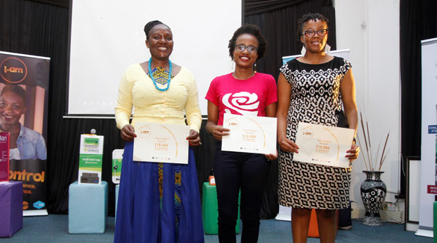 The winners of the I AM 2.O sexual reproductive health solutions contest in Naiorbi parade with their certificates.