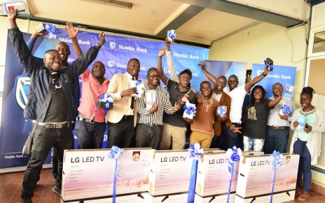 24 lucky winners of the 12 Days of Christmas Campaign pause for a group photo with their gifts at the Stanbic Bank Headquarters. The campaign which kicked off on 4th December and ended on the 19th of Dece.jpg
