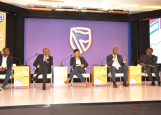 Patrick Mweheire, Stanbic Bank Uganda Chief Executive (2nd Right) responds to one of the questions paused during the panel discussion at the 2019 Stanbic Economic Forum as Paul Busharizi, Public Editor, New Vision (1st Right), Rashmi Pillai, Financial Sector Deepening Uganda Direct of Programs (Centre), Micheal Nyitegeka, ICDL Africa Country Manager (2nd Left), Edgar Kasenene, heat of IOT (1st Left) look on.