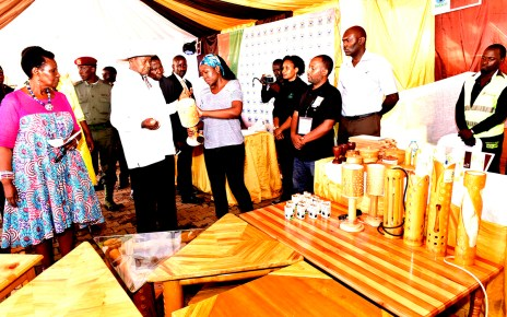 President Museveni touring the stalls at Kololo