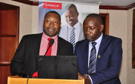 (L-R) James Byaruhanga, the Raxio Data Centre General Manager and Byron Osiro, the Oracle Senior Cloud Platform Manager, East Africa. Osiro said that there was need for regulatory support so as to encourage businesses in Uganda to quickly adopt and benefit from the immense benefits presented by cloud services.