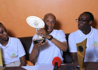 Henry Ngabirano shows one of the many awards won by the business