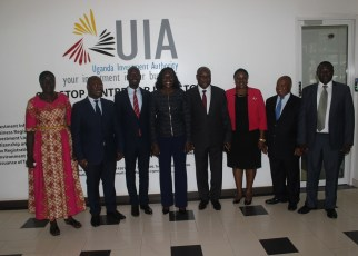 Uganda's State Minister for Investment Evelyn Anite (4L) with the New Board Members of Uganda Investment Authority.