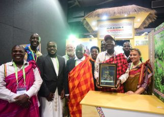 Prof. Ephraim Kamuntu, the Minister of Tourism Wildlife and Antiquities holds the Gold Award certificate presented to Uganda Tourism Board in the category of Southern Africa Development Community and Africa.
