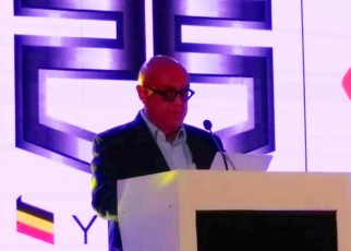Roofings Group chairman Sikander Lalani addressing the audience in Namanve on Tuesday