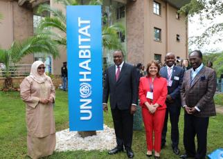 President Uhuru Kenyatta of Kenyam the UN-Habitat Executive Director, Maimunah Mohd Sharif, and the newly elected President of the UN-Habitat Assembly Martha Delgado at the unveiling of the new UN-Habitat sign outside the Agency's headquarters in Nairobi just before the official opening of the first UN-Habitat Assembly© 2019/UNHabitat