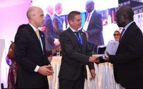 The Vice President of Uganda, Edward Kiwanuka Ssekandi (Right) hands over an award of exceptional performance and contribution towards viral Hepatitis response in Uganda and the world, to Nicolas Granier, General Manager Africa (Centre) Infectious Disease - Markets, Rapid Diagnostics, Abbott and Jerome Clavel (Left), VP Global Marketing, Infectious Disease - Emerging Markets, Rapid Diagnostics, Abbott, during the opening ceremony of the Africa Hepatitis Summit at Speke Resort Munyonyo. Abbott is a manufacturer of medical diagnostics devices and kits.